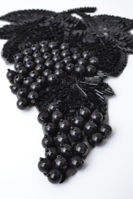 Fig leaf design, black balls, beads and spangles