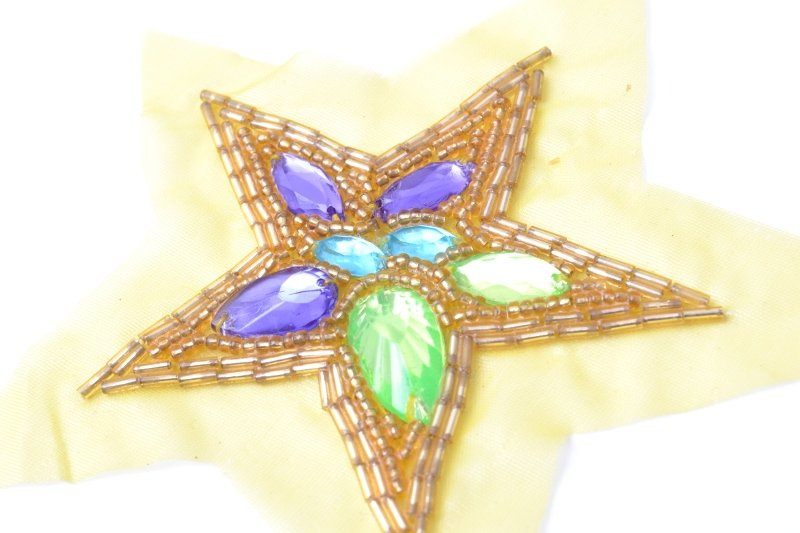 Star design, beads and spangles